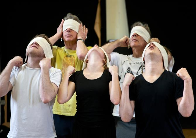 Rehearsal image of cast members blindfolded.
