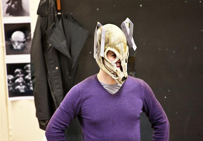 Rehearsal image of John Hopkins, wearing a mask.