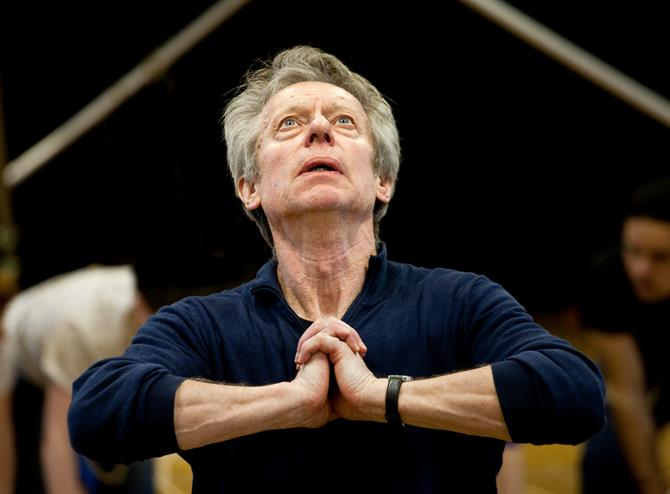 Rehearsal image of Stephen Boxer, hands together in prayer.