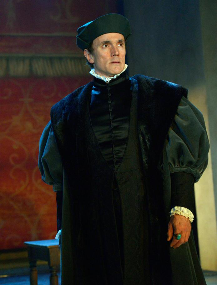 Ben Miles as Thomas Cromwell, in black silks and furs.