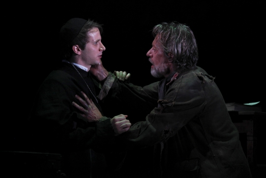 Mark Quartley as Catholic Priest and Stephen Boxer as William Tyndale in Written on the Heart.