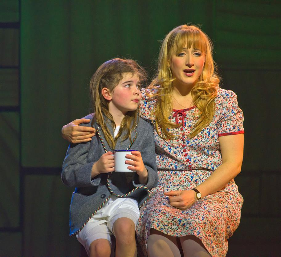 Matilda drinks a cup of tea with Miss Honey