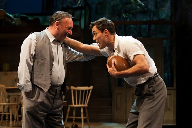 Alex Hassell and Antony Sher stand on stage