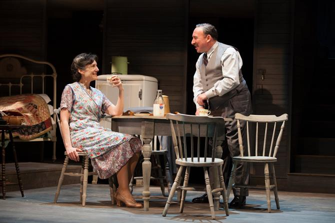 Antony Sher stands behind a table as Harriet Walter sits