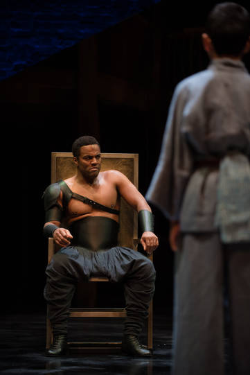 Ray Fearon as Agamemnon seated on a throne
