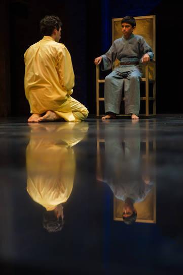 Edmund Kingsley as Polymestor and Nilay Sah, seated on a throne, as Polydorus in Hecuba