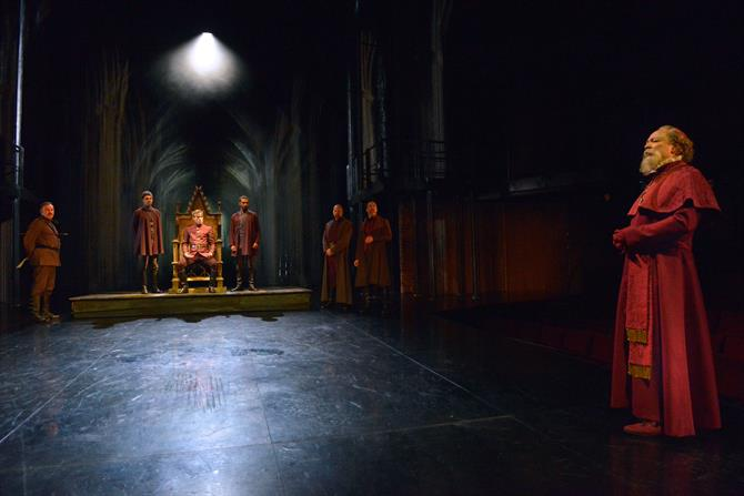 Jim Hooper as Cantebury and the cast of Henry V in Henry V