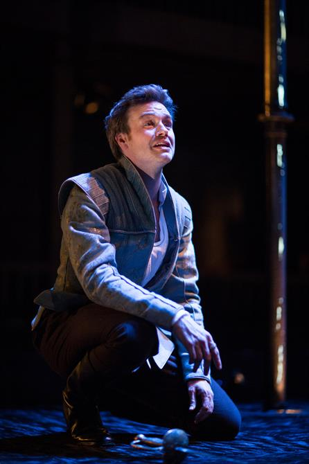 Production image of  Fernando (Jamie Thomas King) kneeling in Love's Sacrifice.