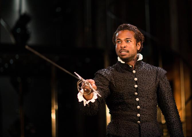 Production of Roseilli (Marcus Griffiths) brandishing a sword in Love's Sacrifice.