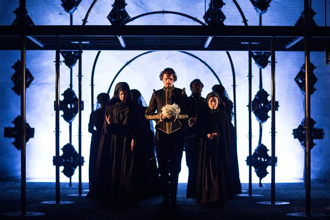 Duke of Pavy (Matthew Needham) holding flowers to lay and the cast of Love's Sacrifice.