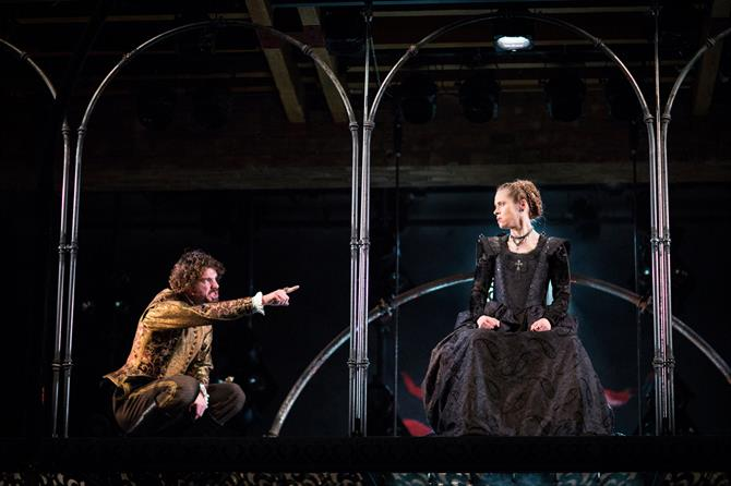 Production image of Duke of Pavy pointing towards (Matthew Needham) and Fiormonda (Beth Cordingly) in Love's Sacrifice.