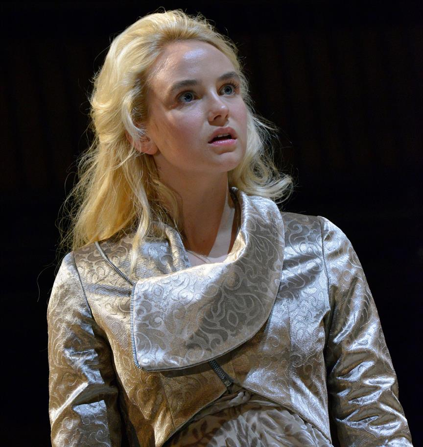 Joanna Vanderham looking shocked, wearing a luxurious silver gown