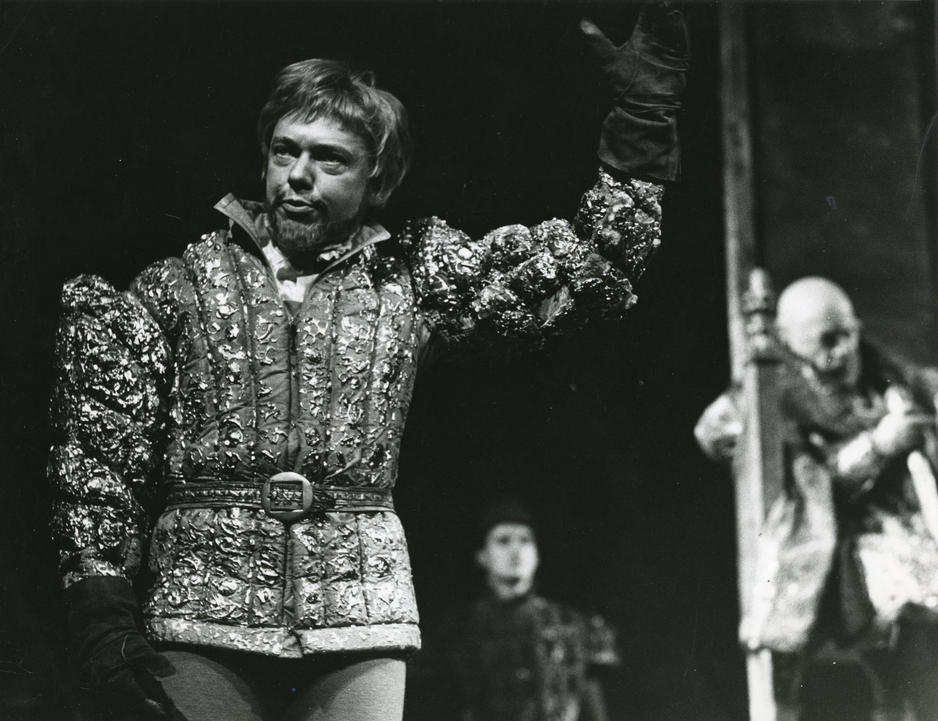 The Dauphin raises his hand in command in the 1965 production of Henry V