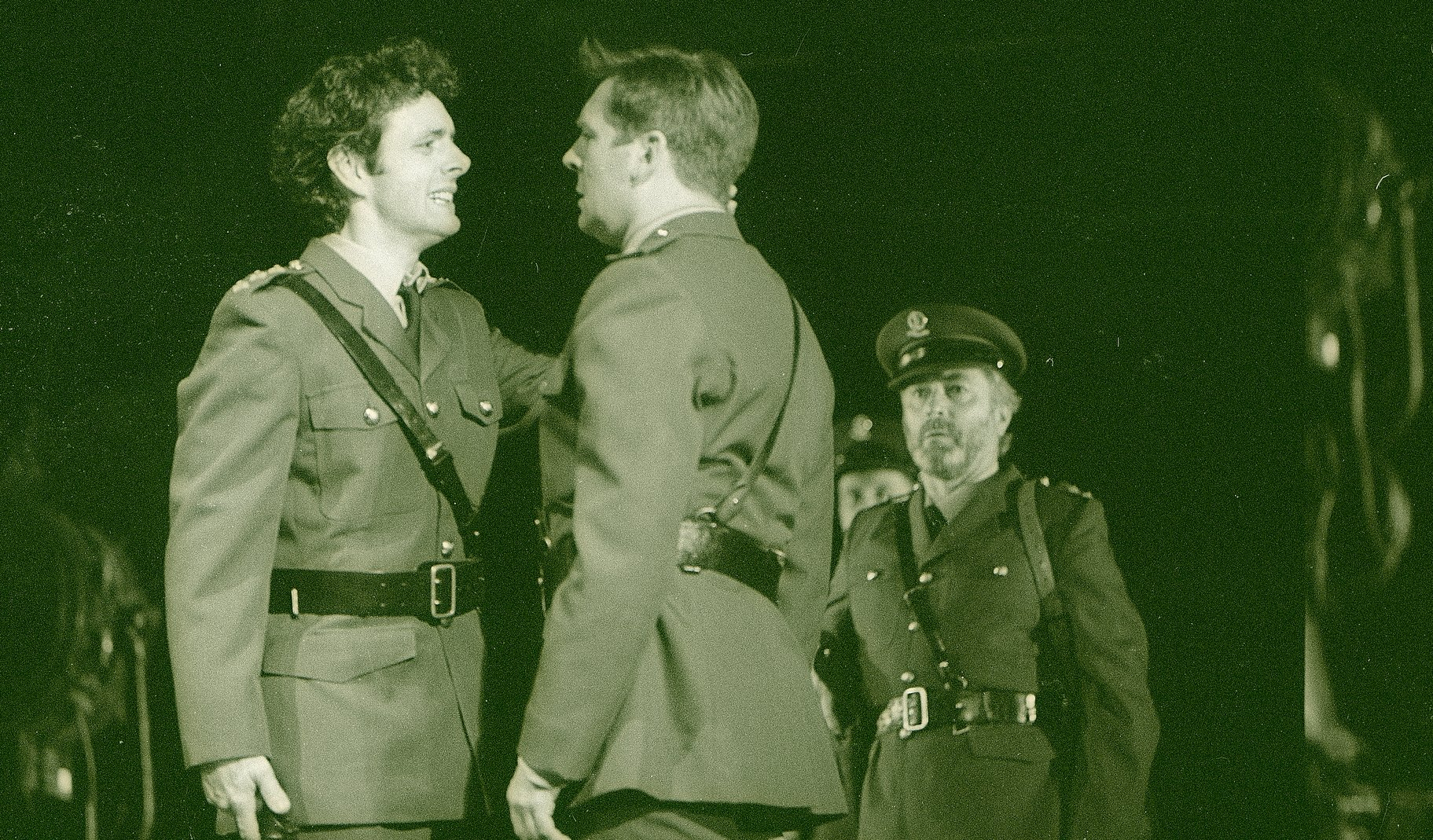 Henry confronts the traitors, all dressed in military uniform, in the 1997 production of Henry V