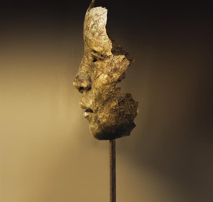 A gold mask viewed from side