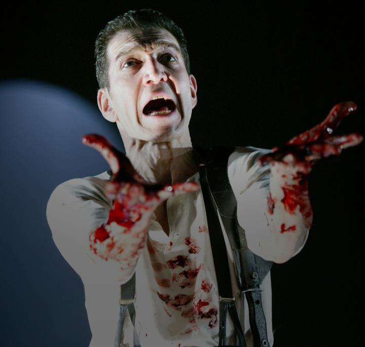 Macbeth showing his blooded hands