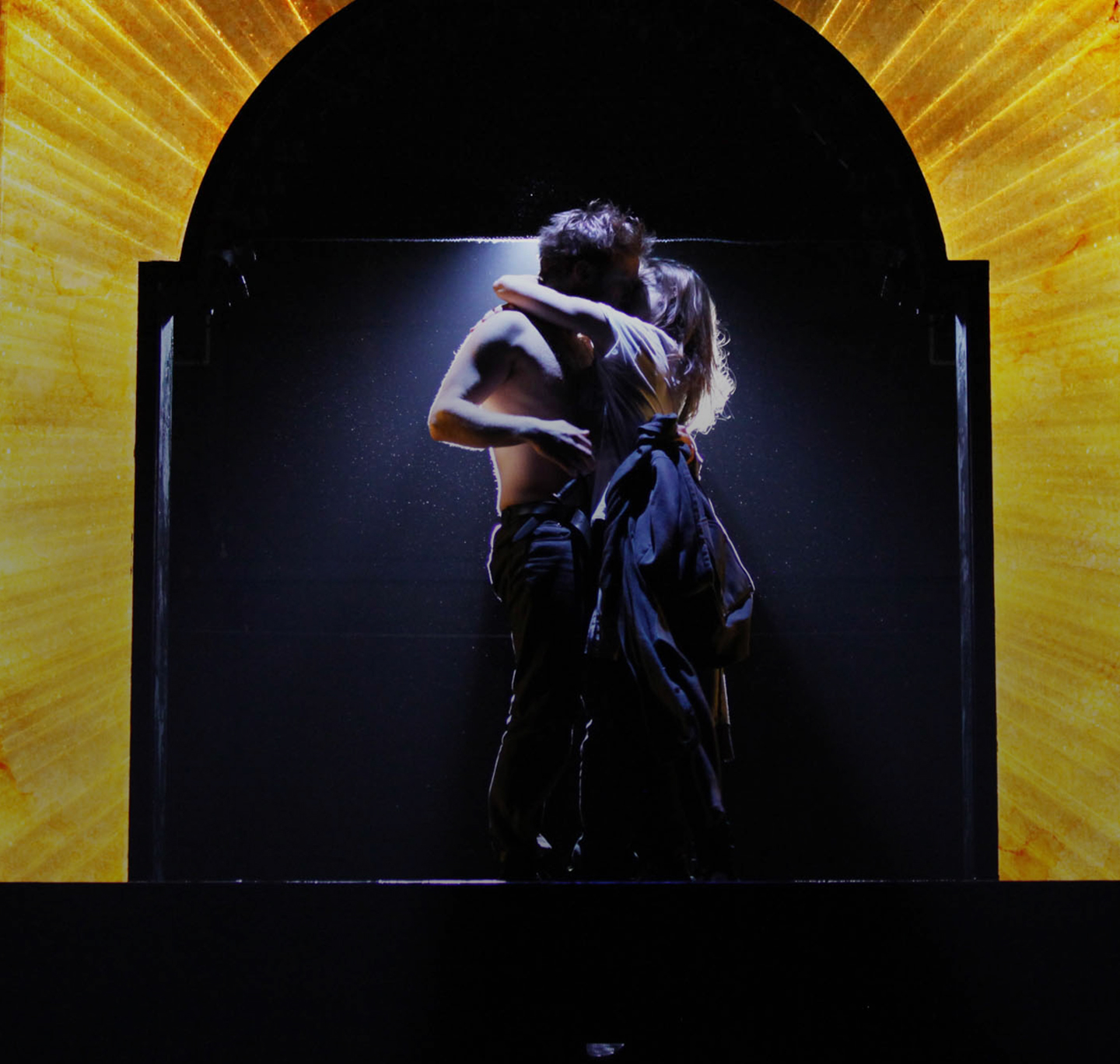 Man and women kiss on stage